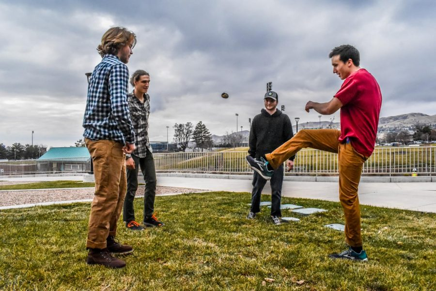Photos by Julián Askov. University of Utah Hacky Sack club hackys it up outside of the Student Life Center.