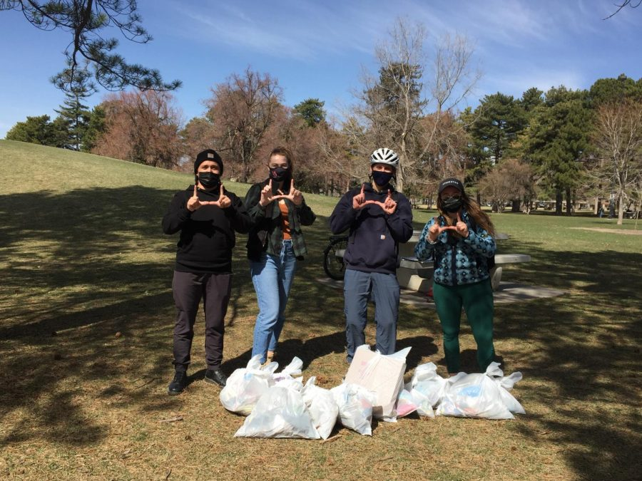From left to right: Anders Eckert, Allison Liddle, Sam Karthan, and Kyra Mann cleaning up trash at Liberty Park.